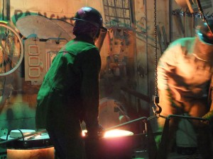 The Molten Bronze is Lifted Out of the Furnace in a Container Called a Crucible