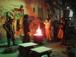 Molten Bronze Hoisted out of the Furnace